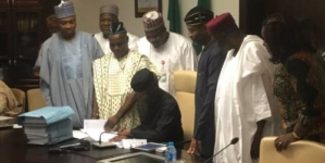 ( UPDATED) Osinbajo signs 2017 Budget