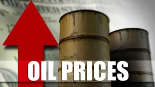 Oil bounces above $63 after slide, but glut worries persist