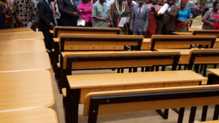 Champion Breweries donate over 200 chairs, desks to school in Akwa Ibom.