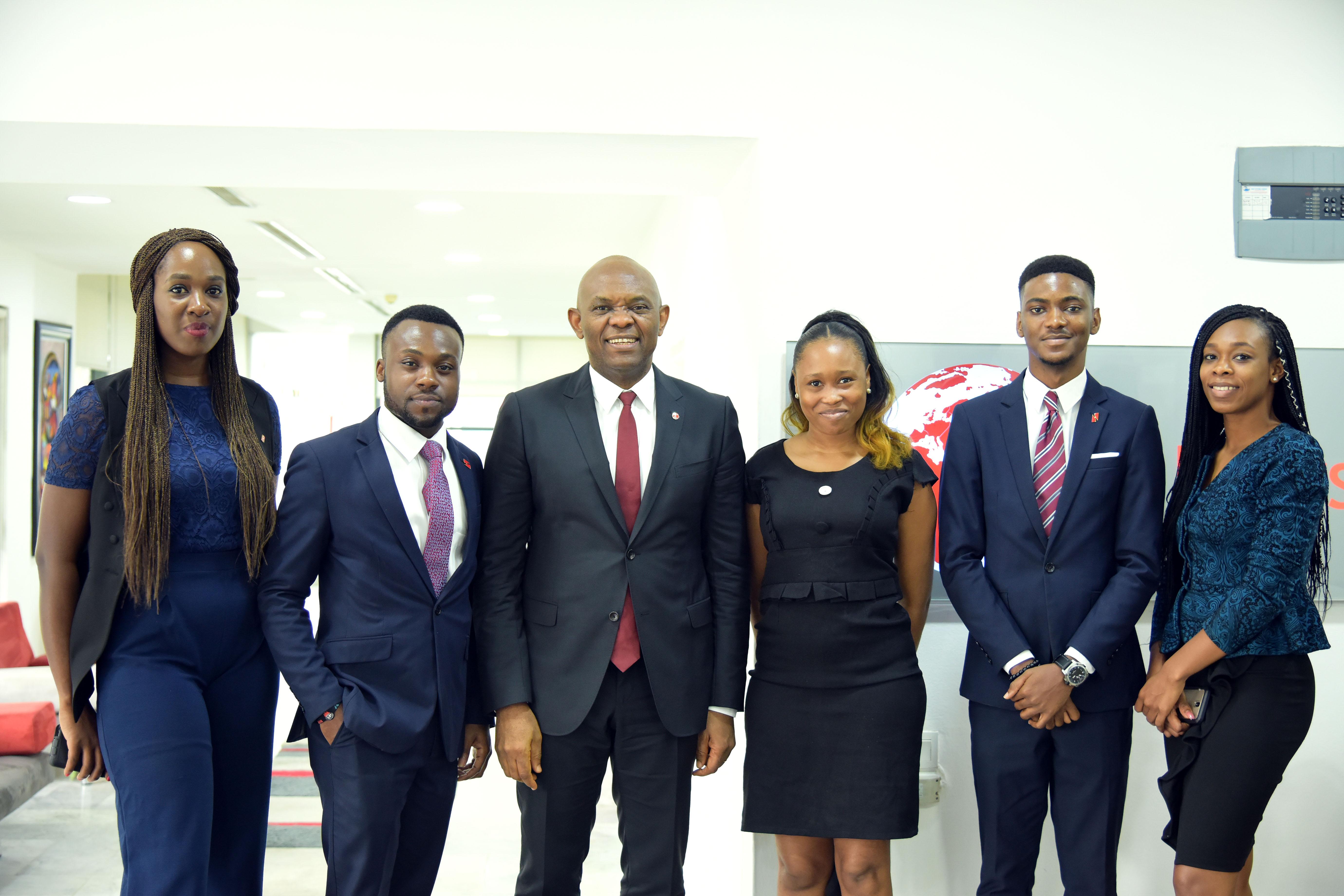 Photo: Tony Elumelu chats with young UBA hires