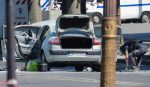 Car loaded with weapons rams police van in Paris, armed suspect dead