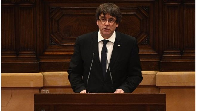 Catalonian's leader suspends independence, calls for dialogue