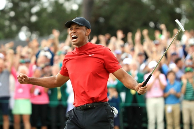 The Masters: Tiger Woods roars to first victory in 11 years