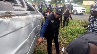 Investigative panel visits scene of the killing of police officers by soldiers